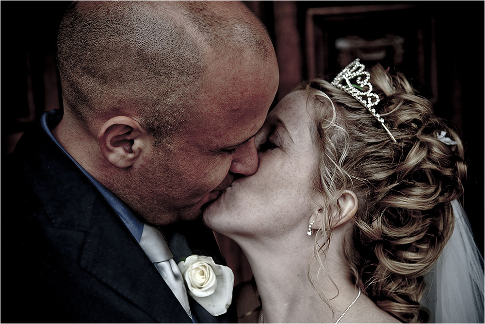 Bride and Groom kissing after their wedding.  Photography Copyright © Mick House, All Rights Reserved