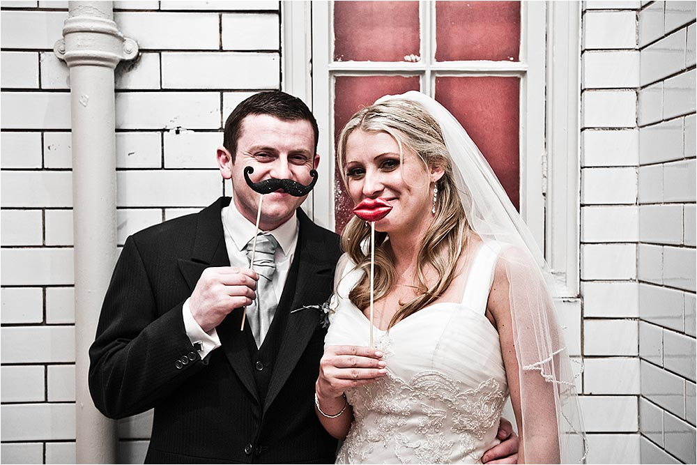 Pelham House, Lewes wedding with false lips and moustache.  Photography Copyright © Mick House, All Rights Reserved