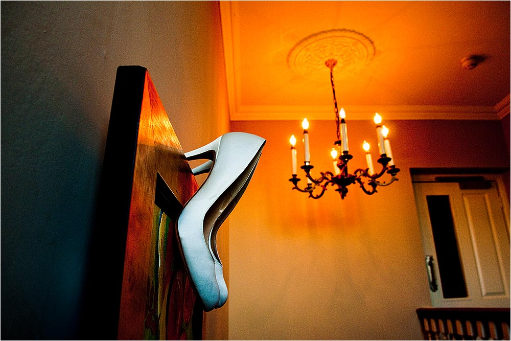 White bridal shoes hanging on a picture.  Photography Copyright © Mick House, All Rights Reserved