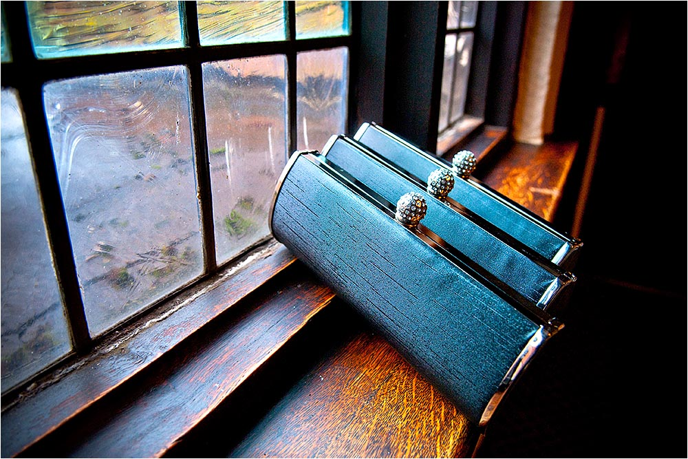 Three bridesmaids purses on a windowsill.  Photography Copyright © Mick House, All Rights Reserved