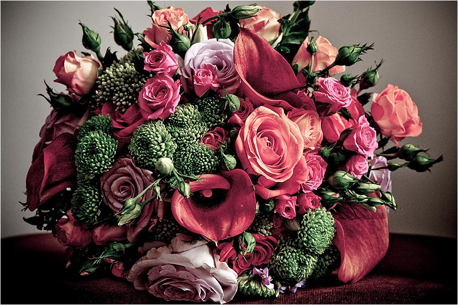 Beautiful brial bouquet in pink green red and peach.  Photography Copyright © Mick House, All Rights Reserved