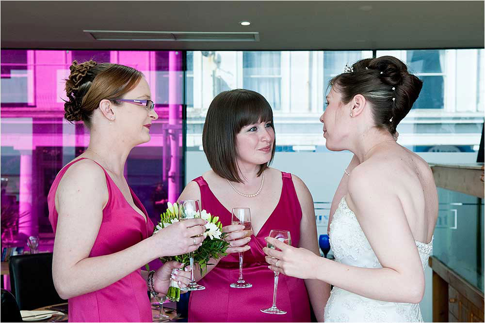 Suzanne talking with her bridesmaids after the wedding ceremony[