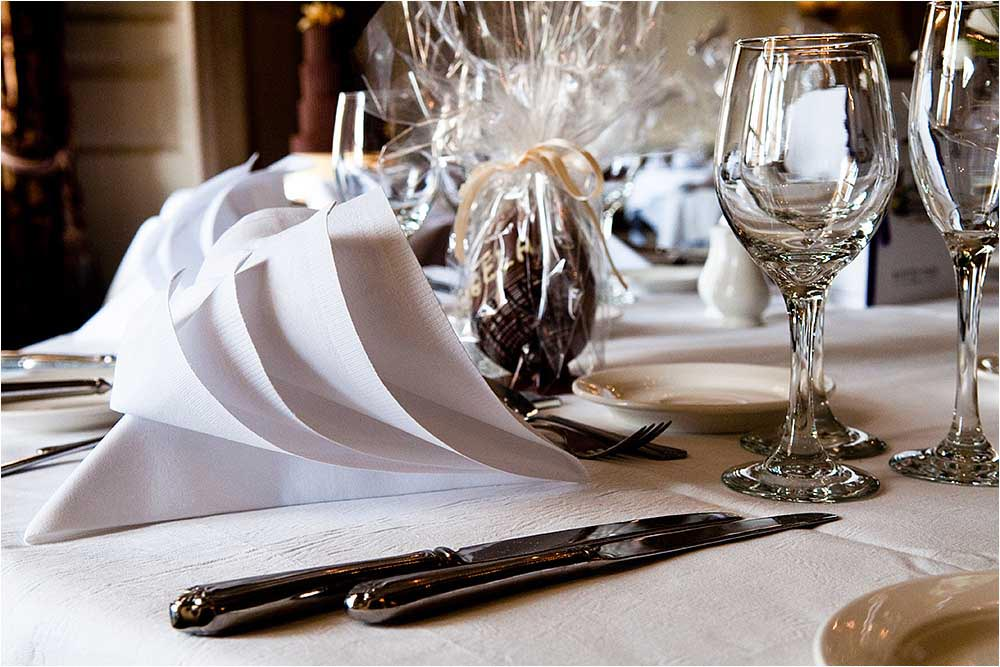Table setting of cutlery, napkins and glasses