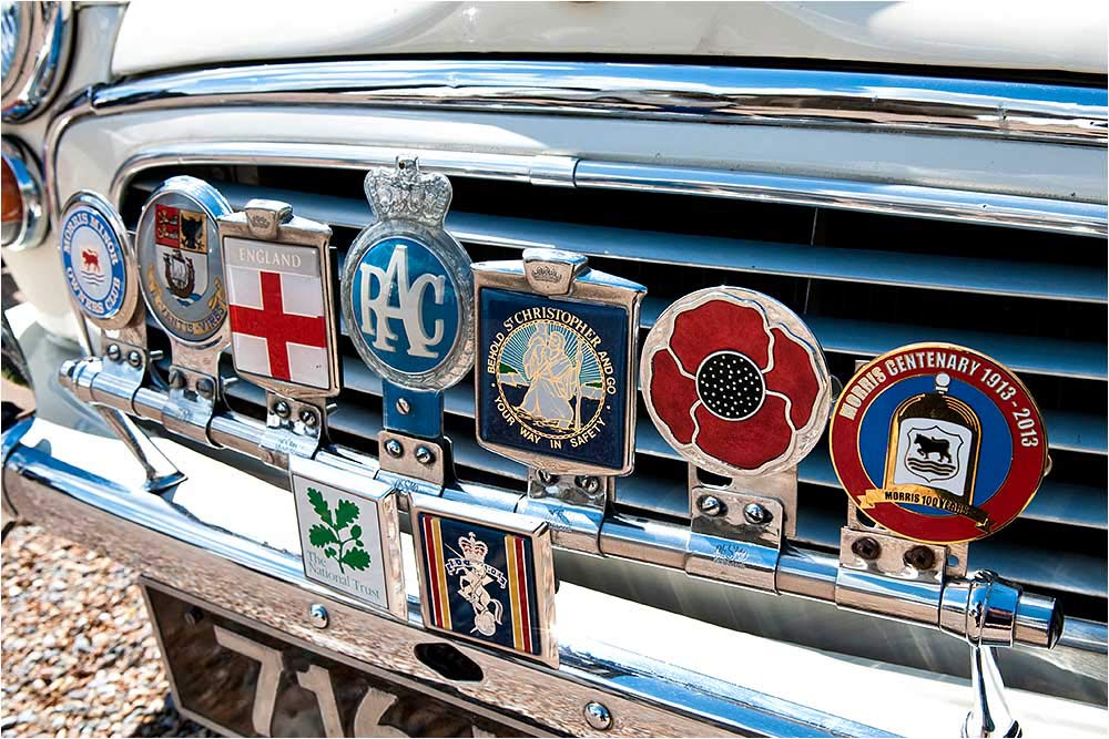 A collection of colourful car badges on the radiator grill