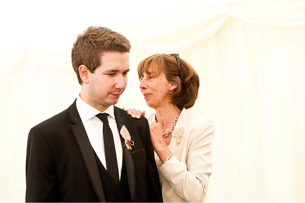 Ben has a quiet moment with his mum before the ceremony
