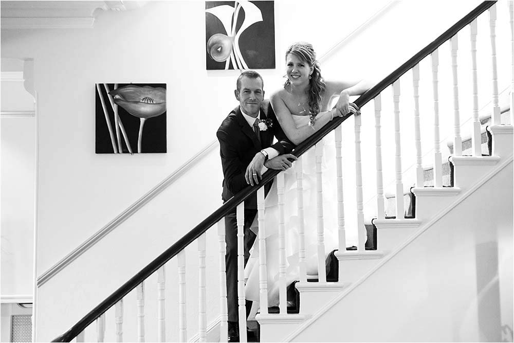 Black and white photograph of the couple on a staircase