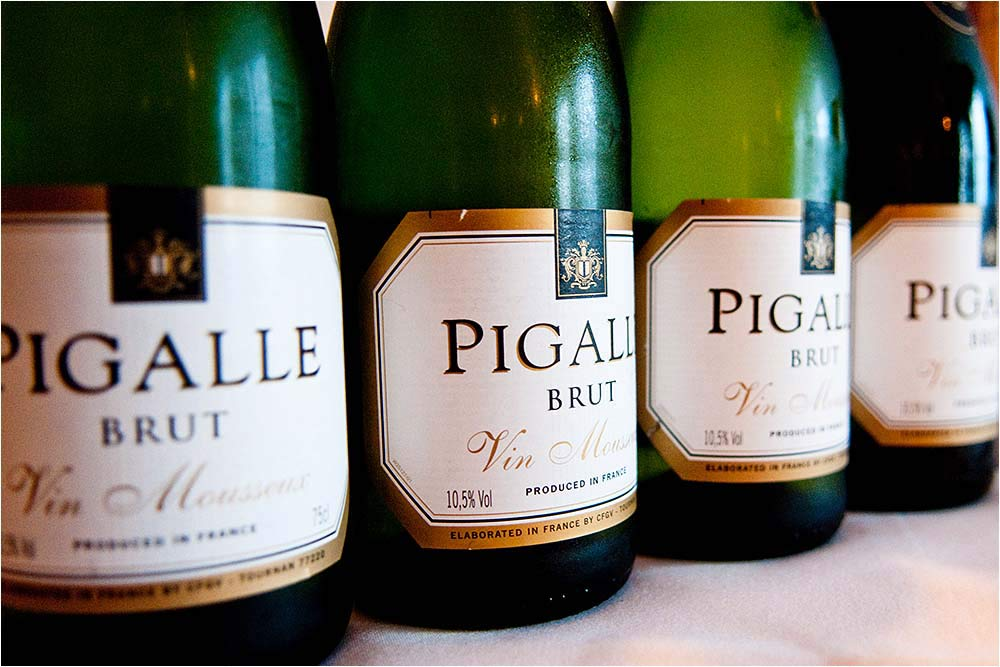 Four bottles of Pigalle Brut wine chilled and ready to be served